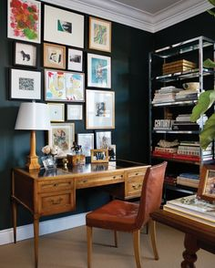 dark walls + vintage lamp, desk, and chair + modern bookshelf + inspirational artwork
