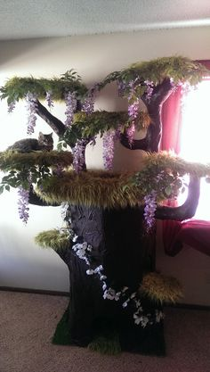 cat tree with wisteria and fake fur From Random pictures of the day: no source given. The kitties can shred the flowers/greenery and the carpeting. Diy Pour Chien, Cat Tree House, Cat House Diy, Diy Cat Tree, Cat Enclosure, Cat Room, Cat Condo, Animal Projects, Space Cat