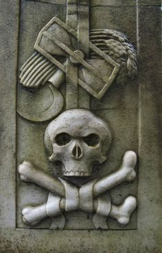 Symbols of death on a tomb in Necropolis of Alexander Nevsky Lavra [Lazarevskoe Cemetery] in Saint Petersburg, Russia