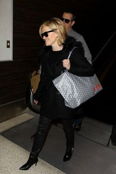 Reese Witherspoon - Reese Witherspoon and Jim Toth at LAX - Goyard bag