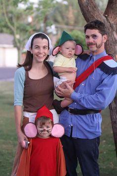 Cinderella Family Costumes--I love how the dad didn't go for the prince, but for the guy with the monocle--nice!