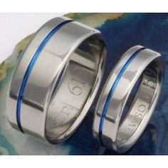 Matching Thin blue line titanium rings flat profile and the off-center groove handcrafted here in the USA to be worn as either a wedding band or promise ring especially for the active man and woman.