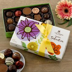 The perfect go-to gift for Mom!  A colorful gift box with all of our most popular confections like truffles, caramels and peanut butter cups!