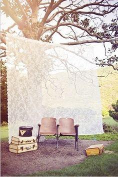 Lace backdrop out doors sun hitting it, gorgeous!
