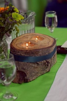 DIY Colorado Rocky Mountain Ranch Rustic Wedding | Confetti Daydreams | Using wood from old trees, Andrew created these unique rustic tea candle holders for their table decor.