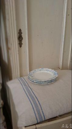 Vintage stool and blue plates