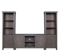 Boston Interiors Arden entertainment wall, Stocked in a ash finish. The Arden entertainment wall features piers with two adjustable shelves on top and one adjustable shelf behind a bottom door