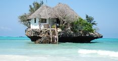 The Rock Restaurant, Zanzibar, Tanzania ... that's a restaurant on a rock island and I want to eat there!