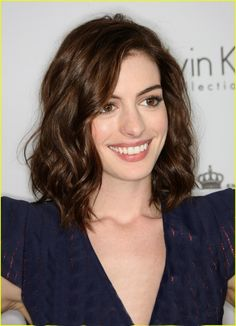 Tousled medium length brown hairstyle Cutting my hair this short but ill have a little more curl in mine
