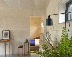 Prefabricated garden studio is clad in cedar and lined in birch