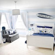A surfer toddler room. blue, white and grey with surf board wall decor. Love the blue and white striped walls. #boybedroomideas #boyroom