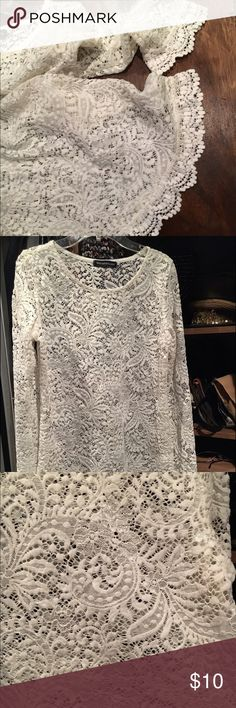 Lace eyelet top blouse shirt m Long sleeve lace top with ruffle sleeve and bottom hem. stretchy lace material super cute and classy . Wear with the skirt Jean shorts crewneck versatile. Medium. Tops Blouses