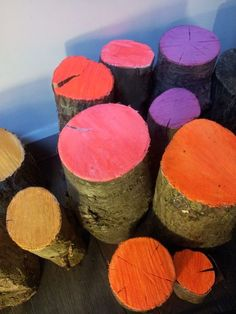 Add a pop of color to your fall display by painting these log ends!