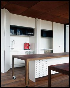 hidden kitchen and table on castors (prep bench then dining table)