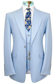 William Hunt Savile Row Slate grey three piece single breasted peak lapel suit featuring a black base lining with multi-coloured floral pattern. Sky Blue Suit, Blue Suit Men, Blue Suits, Men's Suits, Dress Suits, Men Dress, Dresses, Blue Three Piece Suit, Made To Measure Suits