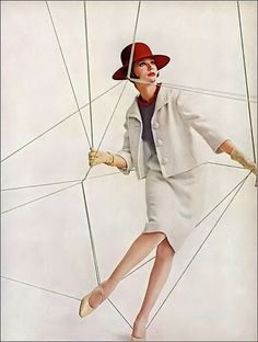 •Simone d'Aillencourt in suit of nubby off-white wool tweed with navy linen overblouse by Bardley, burgundy felt hat by Mr. John, photo by Melvin Sokolsky, Harper's Bazaar, February 1961•
