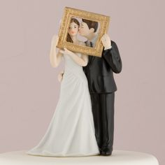 """Poised for a """"Picture Perfect"""" portrait, this sweet couple will complement almost any cake design or color theme. Hand painted porcelain. •8 cm Long, 13.5 cm Tall, Weight: 159 g, Base: 7.94 x 6.03 •Ha"""