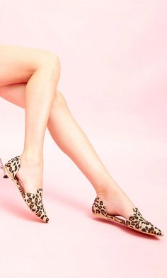 Leopard print d'Orsay flat with a pointed toe and an elastic detail at back heel to keep foot in place.