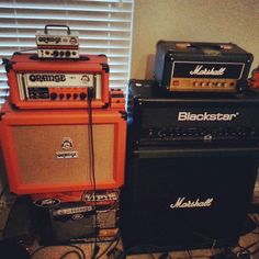 Orange Micro Terror, and a Orange OR15 with a Orange PPC 112 cab (left)   Marshall JCM 1, and Blackstar ID:100 with a Marshall MG412 cab (right)