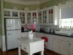 Vintage fridge, glass front cabinets, island