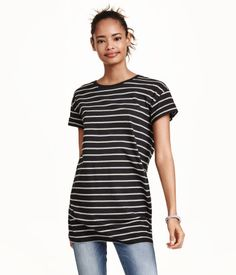 Long T-shirt in jersey with sewn-in turn-ups on the sleeves.