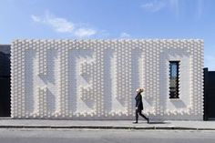 OOF! Architecture worked together with artist Rose Nolan, to create the Hello House, which features an exterior brick wall of the artists work. The house is located in Richmond, a suburb of Melbourne, Australia.