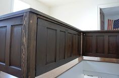 Stairwell enclosed with salvaged doors. This post shows how salvaged materials were used to give a bland new house much-needed character.
