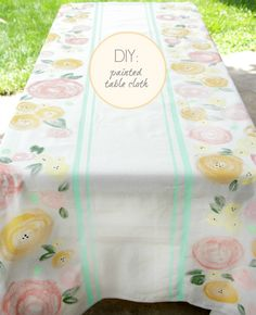 DIY Handpainted Outdoor Tablecloth made out of a drop cloth.