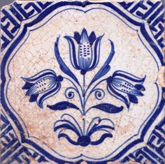 Mid-17th century Dutch tile with tulips and Chinese Wan-Li corner motifs. Holland was first exposed to blue Chinese porcelain around 1602 due to trade with China. The Dutch/Chinese artistic fusion is wonderfully compatible.