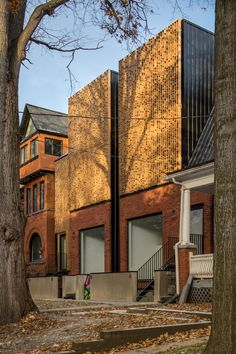 Canadian studio Batay-Csorba Architects has created a pair of slender residential buildings in central Toronto that pay heed to the craftsmanship found in the area's historic architecture.