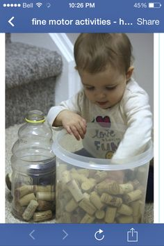 Infant fine motor activity Fine motor 5.2.A transferring objects. Need bigger objects for toddler/infant. Toilet paper tube rule.