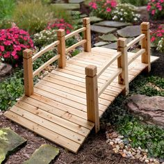 Wood Plank Garden Bridge with Rails. Have wanted this bridge for several years. It would also look great with Mexican blue stones beneath it, creating another type of dry river bed effect