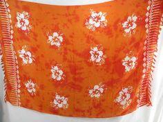 orange monocolor sarong with gecko, flower, turtel, fish, sun, dolphin, seashell, palm trees etc tropical designs $5.25 - http://www.wholesalesarong.com/blog/orange-monocolor-sarong-with-gecko-flower-turtel-fish-sun-dolphin-seashell-palm-trees-etc-tropical-designs-5-25/