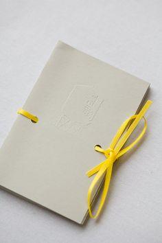 wedding program with ribbon tie