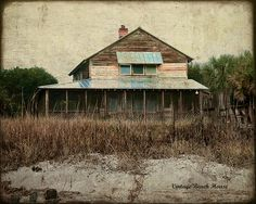 Arrogantly shabby is what the islanders call Pawleys. A look into the past (pre Hurricane Hugo) and most of the beach houses looked like this. Hugo took most of them away so in order to rebuild up came the modern beach homes. I always smile when I see the lovely old ones. What would they tell us. So much to say for the last hundred years. The kids with sandy feet messing up the floors....the home cooking on the stove...the sounds of seagulls... the radio on (No TV!). Simpler life then.