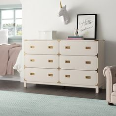 White and gold girls dresser - Dreamy grey and pink peony nursery with swan decor • Girls floral nursery • Swan nusery • Pink peony nursery with gray rocking glider, silver tufted crib, pink flower wall decals, tulle canopy and swan decor Chandeliers and Champagne