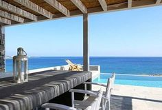The property's private infinity pool is included in the lower terrace where the water seems to overflow directly into the sea given the waterfront position.