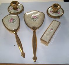 This is a beautiful vanity set made in England. The set includes 2 brushes, hand mirror, and candle holder set. White lace with a pink rose in Vintage Dressers, Vintage Vanity, Art Deco Vanity, Shabby Chic Pink, Candle Holder Set, White Gold, White Lace, Vanity Set, Victorian