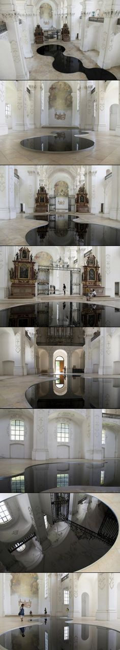 """Installation of Romain Crelier located in Bellelay, Switzerland, 'La mise en Abyme"""" is composed of large basins filled with used motor oil in which the image of spectators is reflected in the abbey grandiose baroque decor. A very interesting diversion work"""