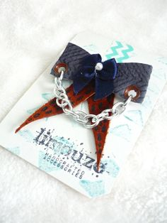 This hand-printed leather bow is very sweet!    The leather is hand cut and hand-printed with a specialized permanent ink and then shaped into a cute