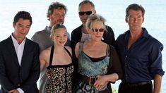 British actor Dominic Cooper, British actor Colin Firth, US actress Amanda Seyfried, Swedish actor Stellan Skarsgard, US actress Meryl Streep and Irish actor Pierce Brosnan pose during a photo opportunity for the promotion of the new movie 'Mamma Mia' at the Lagonissi Grand Resort, some 40 kms south of Athens on June 28, 2008