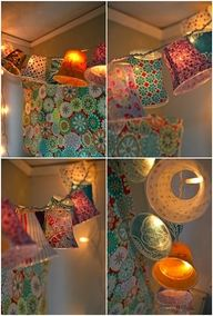wrap plastic cups in fabric and hang from string lights (these are SO cute, it's like making your own little lamp shades) I want this in my craft room.