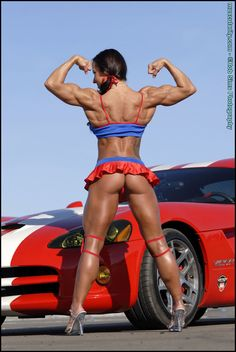 Female Bodybuilder Patricia Beckman posing her hot muscles for Muscularity!