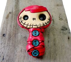 Friendly baby mummy brooch in red with blue buttons. Creepy and cute. Lovely and primitive.