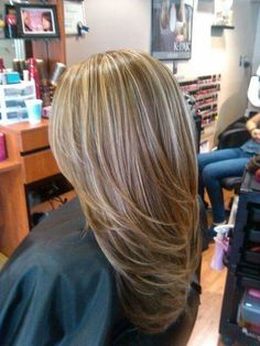 Blonde highlights honey long hair volume fancy light blonde
