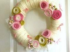 Yarn wreath ... vanilla yarn wrapped wreath ... rolled felt flowers in pinks and chartreusse ... gorgeous!!