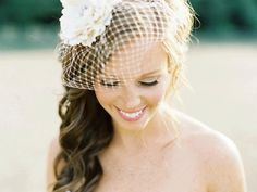 I love this wedding hair/cute birdcage veil. The side swept wavy hair is kind of just magical. Loooove it.