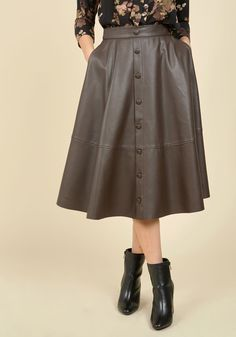 The house party, the client meeting, the dinner date - nothing begins until you arrive in this faux-leather midi skirt! Offering a rich brown hue for versatility, dotted with decorative buttons, and equipped with side pockets, this edgy garment puts you at the top of the list every time.
