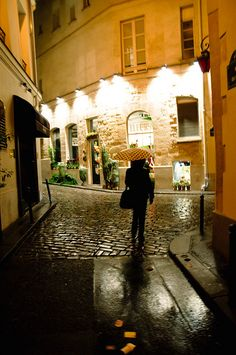 cobblestone street with an umbrella- St Germain Arrondissement) Paris at night Paris At Night, Night City, Rainy Paris, Oh The Places You'll Go, Places To Travel, Places To Visit, Paris Travel, France Travel, Saint Germain