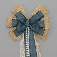"""This denim and burlap wedding bow is accents with lace and pearls. This burlap pew bow is a perfect decoration for a rustic wedding theme. Bow Details: - 6 loops of 2 1/2"""" burlap with wire edge. (Note                                                                                                                                                      More"""